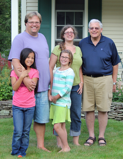 Paul De Vries with his son Chris, daughter-in-law Kim, and grandchildren